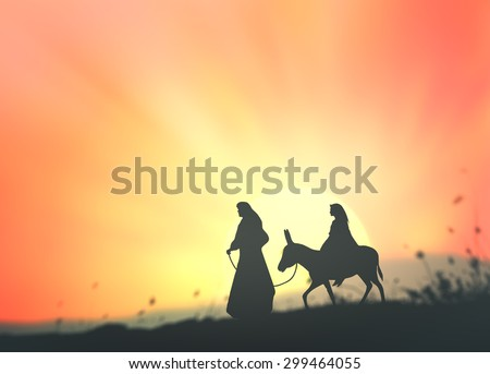 Silhouette Mary and Joseph journeying through the dessert with a donkey on sunset looking for a place to stay on Christmas Eve. Bethlehem city in the background. Nativity scene story concept. - stock photo