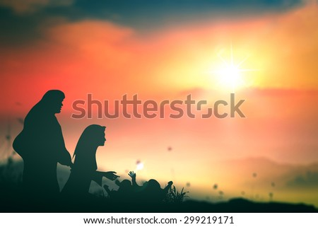 Silhouette Mary, Joseph and Jesus Christ in the manger in Bethlehem on Christmas Eve. Nativity scene story, Christmas background, Happy Birthday, Family, Love, Father, Mothers Day, Messiah concept. - stock photo