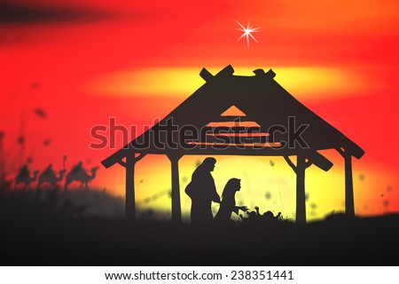 Silhouette Mary, Joseph and Jesus in the manger in Bethlehem on Christmas Eve. - stock photo
