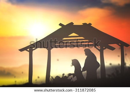 Silhouette Mary, Joseph and Jesus in the manger in Bethlehem on Christmas Eve. Nativity scene story, Glory to God in the highest, and on earth peace among those with whom he is pleased concept. - stock photo