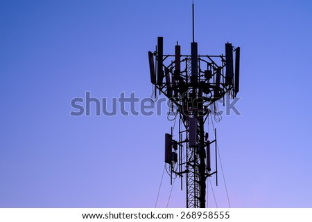 silhouette mobile antenna tower, or silhouette telephone communication tower - stock photo