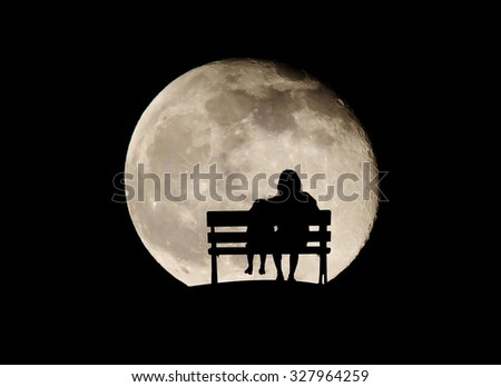 Silhouette mom and child on full moon background