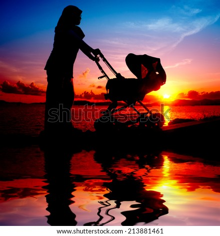 silhouette mother and her child - stock photo