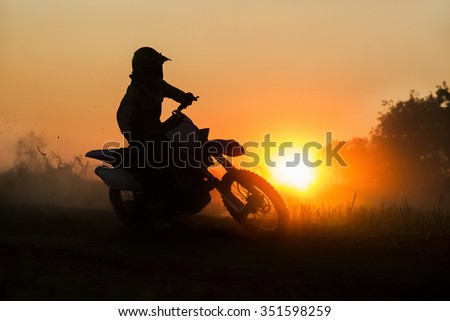 Silhouette motocross speed in track - stock photo