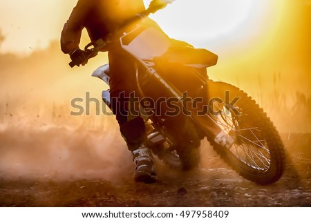 Silhouette motocross speed in track