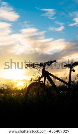 Silhouette Mountain bike at beautiful sunset  - stock photo