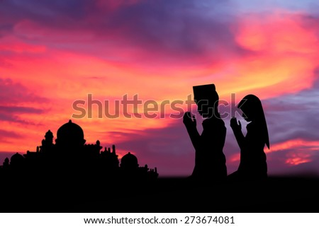 Silhouette muslim people  praying at sunset. - stock photo