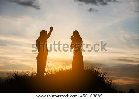 Silhouette of a angry woman and man on each other - stock photo