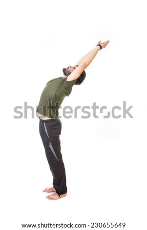 Silhouette of a bearded barefoot man stretching - isolated on white