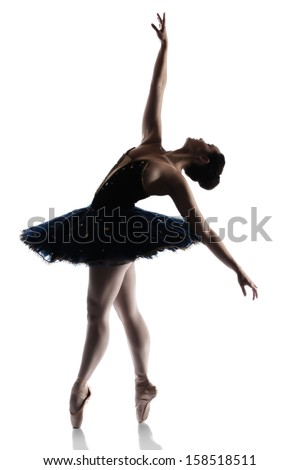 Silhouette of a beautiful female ballet dancer isolated on a white background. Ballerina is wearing a royal blue tutu and pointe shoes. - stock photo