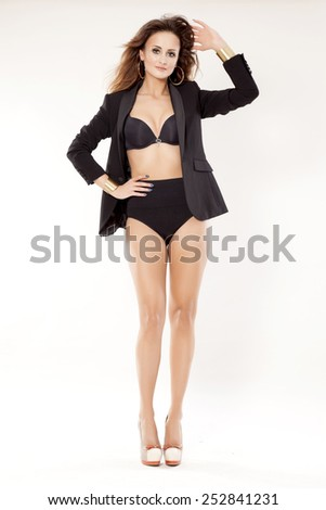 silhouette of a beautiful young adult sensuality sexy and attractive pretty brunette woman in black lingerie bra and panties and elegance jacket isolated on white background - stock photo