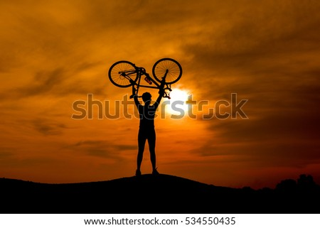 Silhouette of a bike on sky background on sunset.