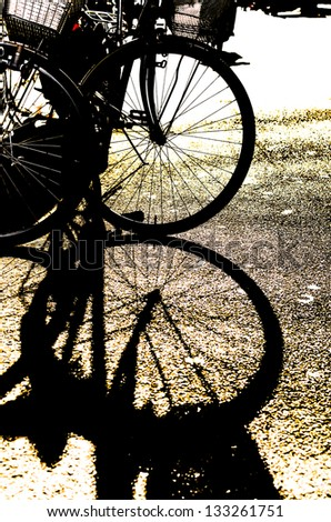 Silhouette of a Bike's Wheel - stock photo