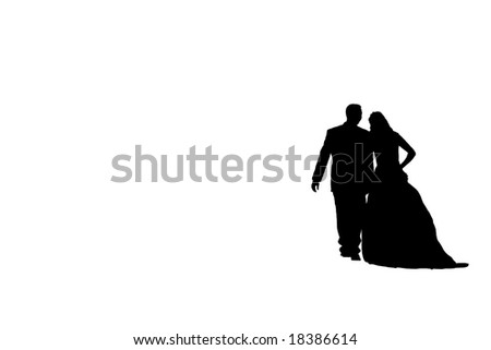 Silhouette of a bride and groom taking a stroll - stock photo