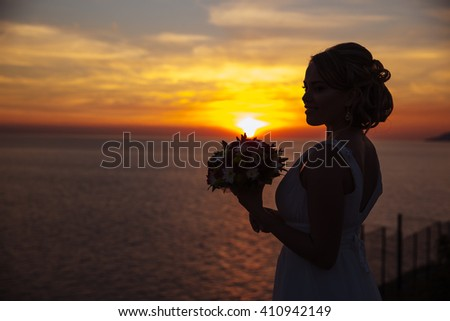 silhouette of a bride on background of ocean