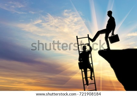 Silhouette of a businessman climbs up the stairs and another businessman pushes this ladder. The concept of inequality and injustice