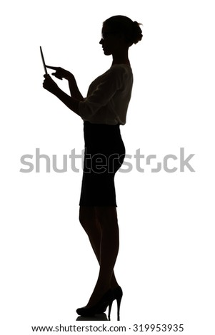 silhouette of a busy business woman backlight studio on white - stock photo