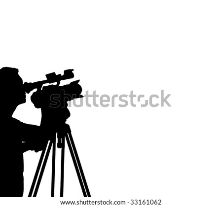 Silhouette of a Cameraman Filming - stock photo
