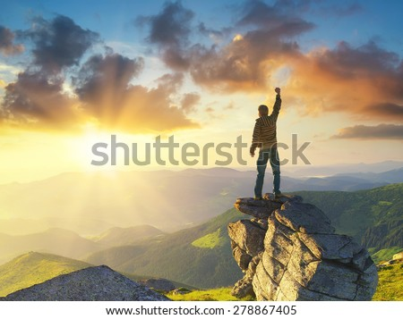 Silhouette of a champion on mountain peak. Active life concept - stock photo