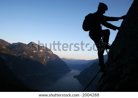 Silhouette of a climber - stock photo