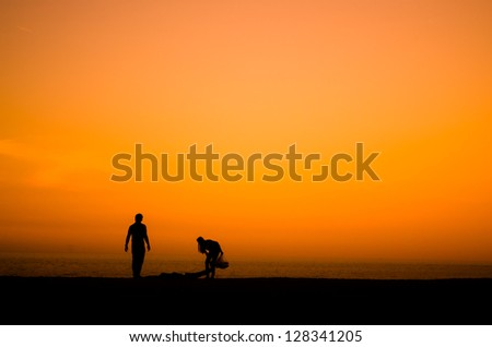silhouette of a couple picnic on the beach