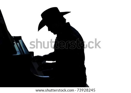 Silhouette of a cowboy paying the piano isolated on white - stock photo