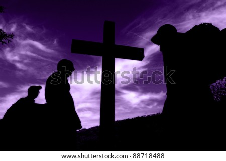 silhouette of a cross, with people in return of it...