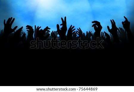 Silhouette of  a crowd with raised hands, either at a concert or on the dance floor in a club. - stock photo