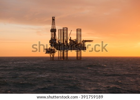 Silhouette of a drilling rig - stock photo