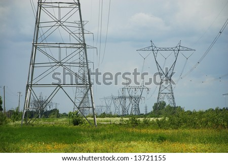 Silhouette of a electric high voltage steel pylons - stock photo