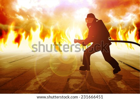 Silhouette of a firefighter in action - stock photo