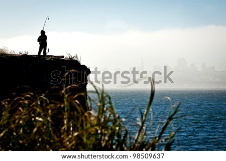 Silhouette of a fisherman in San Francisco - stock photo
