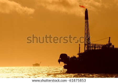 silhouette of a FPSO oil rig.  Bow view.  Coast of Brazil - stock photo