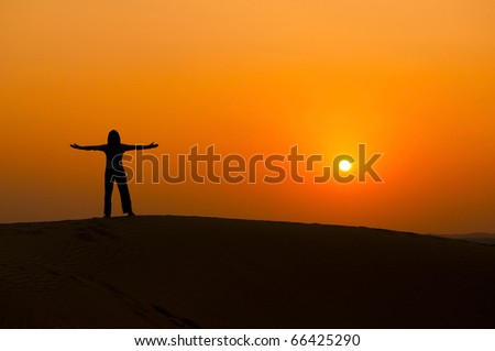 silhouette of a freedom girl on thar sam sand dune desert - stock photo