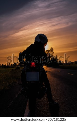 silhouette of a generic sport motorbike and biker. concept of pe - stock photo