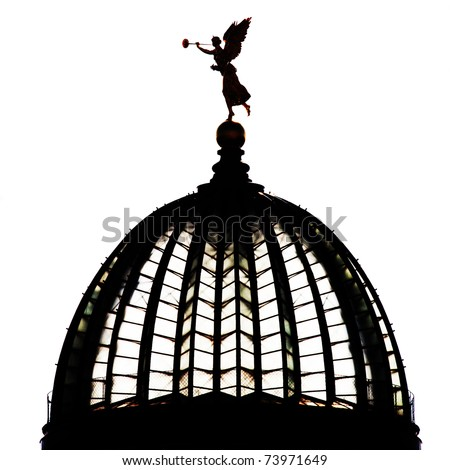 Silhouette of a golden angel on top of the art university building in the city of Dresden in germany - stock photo