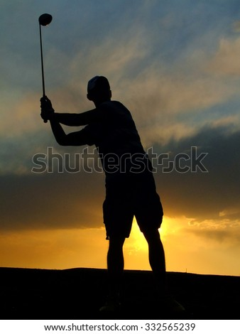 Silhouette of a golf player swinging