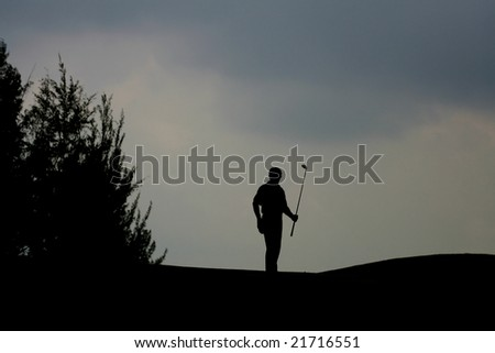 Silhouette of a Golfer - stock photo