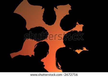 silhouette of a group of people in orange sunset - stock photo