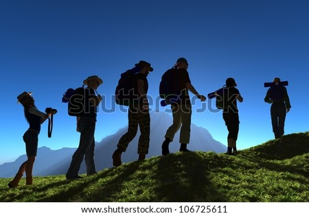 Silhouette of a group of people on the grass. - stock photo