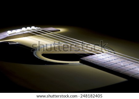 silhouette of a guitar - stock photo