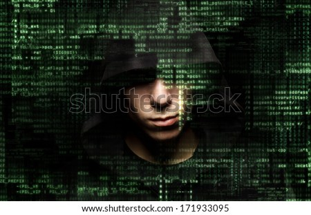 Silhouette of a hacker isolated on black with binary codes on background - stock photo