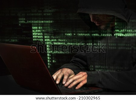 Silhouette of a hacker uses a command on graphic user interface  - stock photo