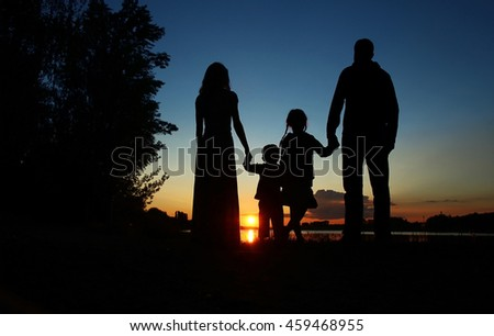 silhouette of a happy family with children - stock photo