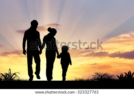 Silhouette of a happy family with children on the background of a sunset