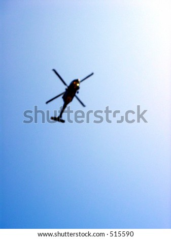 silhouette of a helicopter - stock photo
