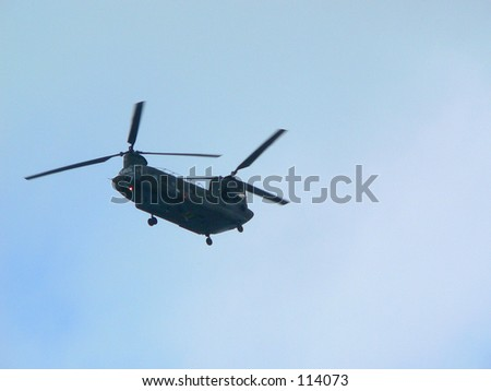Silhouette of a heliocopter. - stock photo