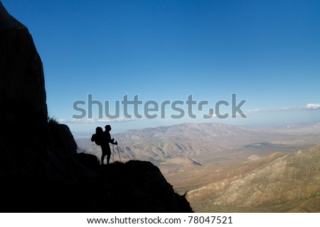 Silhouette of a hiker viewing Anza-Borrego Desert State Park, Southern California, USA - stock photo