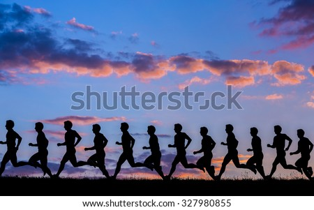 silhouette of a jogger in sunrise - stock photo