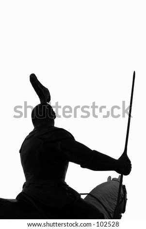 Silhouette of a knight armed and mounted on his steed - stock photo